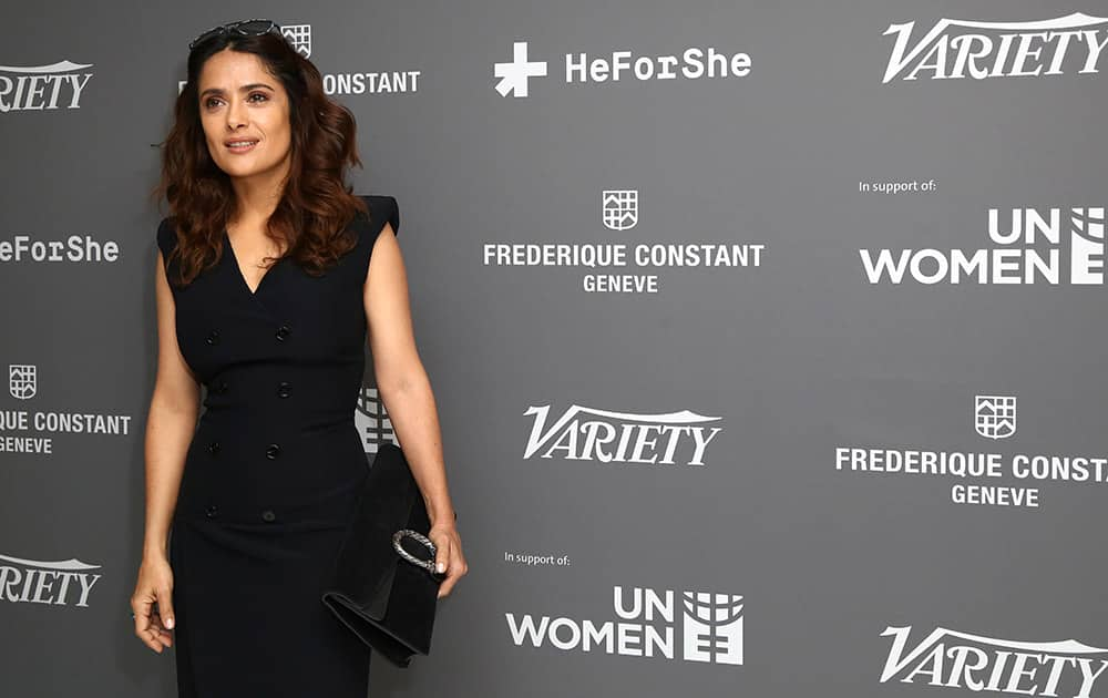 Salma Hayek poses for photographers on arrival at the Variety and UN Women Panel discussion, during the 68th international film festival, Cannes, southern France.