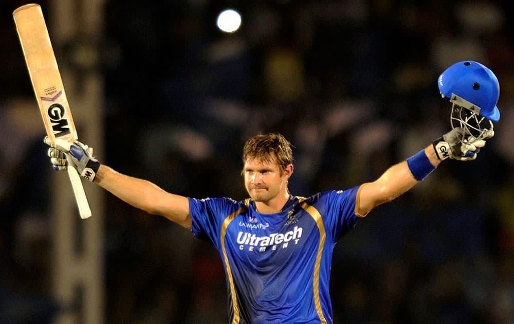 Rajasthan Royals batsman Shane Watson celebrates his century during the IPL match against Kolkata Knight Riders in Mumbai.