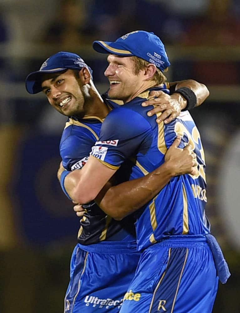 Rajasthan Royals players Shane Watson and Stuart Binny celebrate thier victroy against Kolkata Knight Riders in Mumbai.