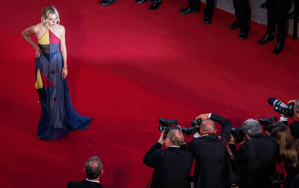 Actress jury member Sienna Miller poses for photographers as she arrives for the screening of the film The Sea of Trees at the 68th international film festival, Cannes.