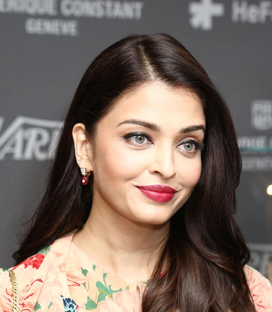 Aishwarya Rai Bachchan poses for photographers on arrival at the Variety and UN Women Panel discussion, during the 68th international film festival, Cannes