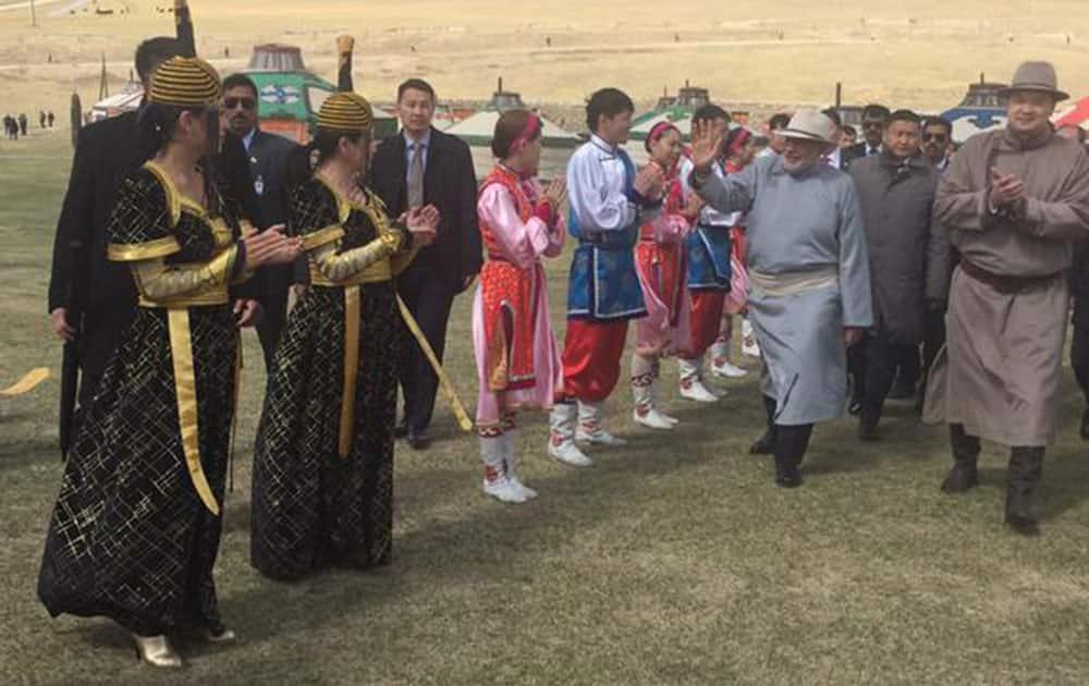 Narendra Modi :- Colourful & vibrant Mini Naadam Festival, in the midst of nature.  -twitter