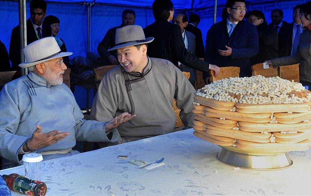 Prime Minister Narendra Modi with his Mongolian counterpart Chimediin Saikhanbileg during the Mini Naadam festival in Ulan Bator.