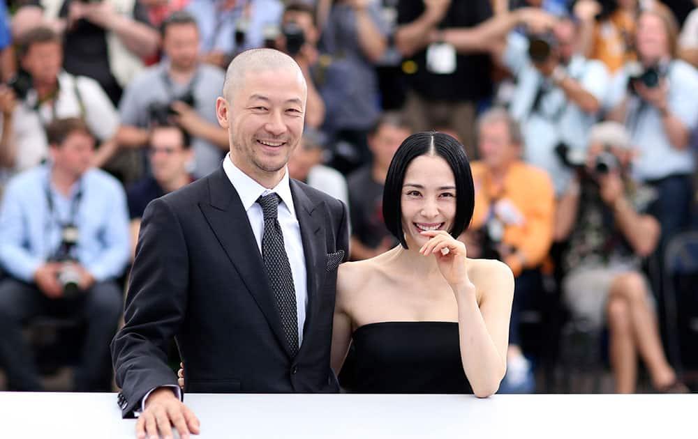 Actors Tadanobu Asano, left, and Eri Fukatsu pose for photographers during a photo call for the film Carol, at the 68th international film festival, Cannes.