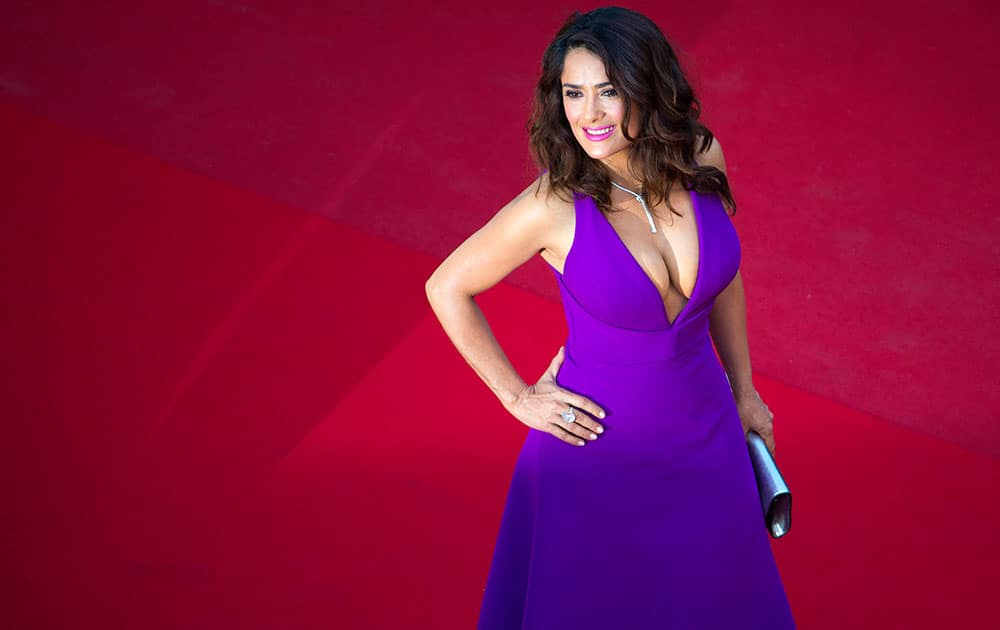 Actress Salma Hayek poses for photographers as she arrives for the screening of the film Carol at the 68th international film festival, Cannes.