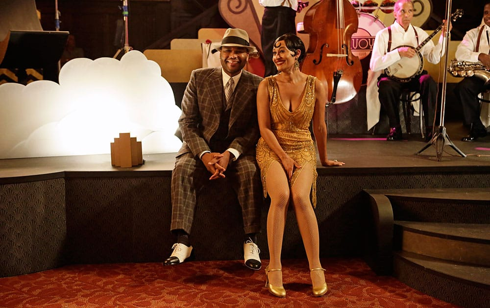 """This photo provided by ABC shows, Anthony Anderson, left, and Tracee Ellis Ross, in a scene from the TV series, """"black-ish""""."""