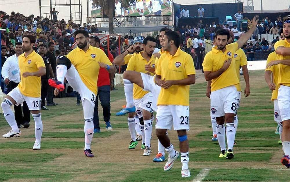 Bollywood actors Ranbir Kapoor, Abhishek Bachchan with All Star Football Club teammates warm up before an exhibition football match against Surat football Team, for underprivileged children in Surat.