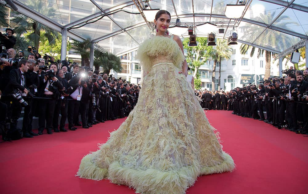 Actress Sonam Kapoor poses for photographers as she arrives for the screening of the film Inside Out at the 68th international film festival, Cannes.-Twitter