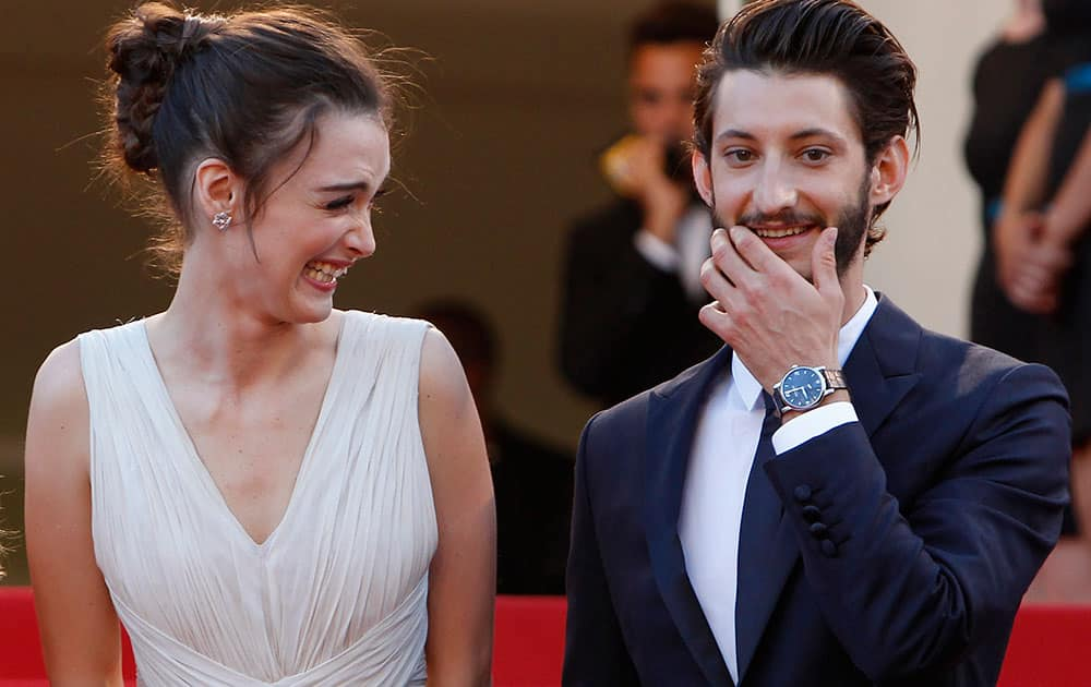 Actress Charlotte Le Bon, left, laughs as she stands alongside actor Pierre Niney upon arrival for the screening of the film Inside Out at the 68th international film festival, Cannes.
