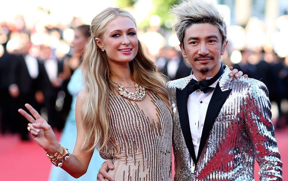 Heiress Paris Hilton, left, poses for photographers with an unidentified guest as she arrives for the screening of the film Inside Out at the 68th international film festival, Cannes.