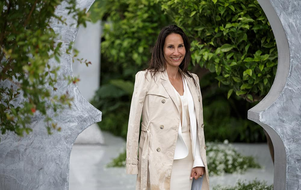 Designer Kamelia Bin Zaal poses for a picture in her garden called The Beauty of Islam by Al Barari at the Chelsea Flower Show in London.