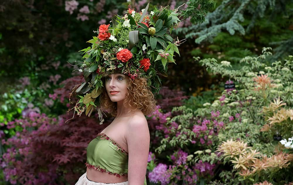 Katherine Warwick Adkins wears a floral hat and dress made by floral stylists Okishima & Simmonds at the Chelsea Flower Show in London.