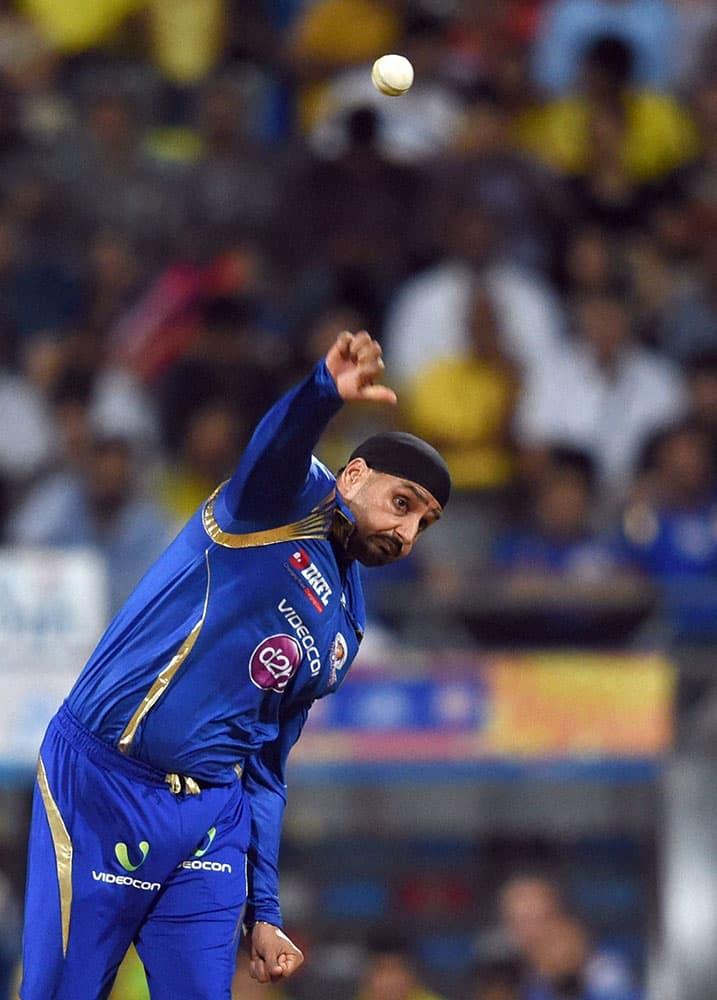 Mumbai Indians player Harbhajan Singh bowls during the first qualifier match of IPL in Mumbai.