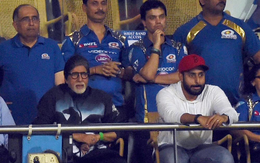 Bollywood Star Amitabh Bachchan alongwith son Abhishek Bachchan during the IPL 8 first qualifier match between Mumbai Indians and Chennai Super Kings in Mumbai.