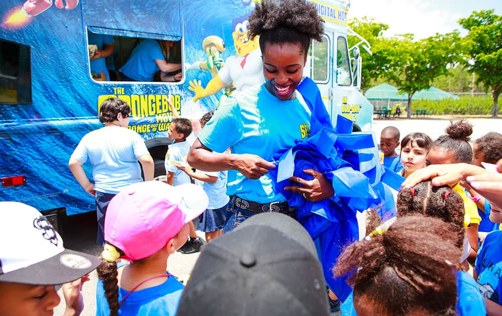 Lucky fans receive free reusable tote bags from the SpongeBob Treat Truck, 2015 at Zoo Miami in Miami, Florida to celebrate World Oceans Day and the home entertainment debut of the blockbuster hit film The SpongeBob Movie: Sponge Out Of Water.