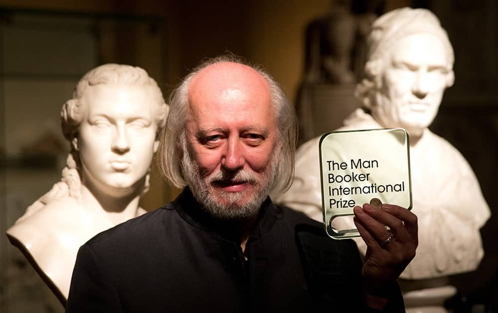 Hungary's Laszlo Krasznahorkai, the winner of the Man Booker International Prize, poses for photographers with the trophy shortly after the award ceremony at the Victoria and Albert Museum in London.