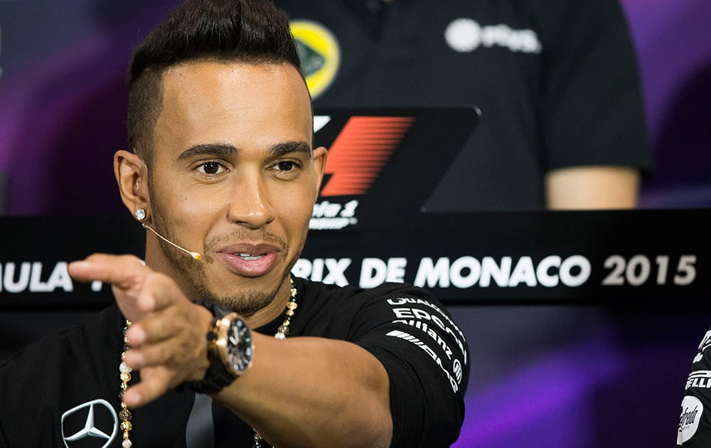 Mercedes driver Lewis Hamilton of Britain gestures during the official news conference prior to the Formula One Grand Prix, at the Monaco racetrack, in Monaco.