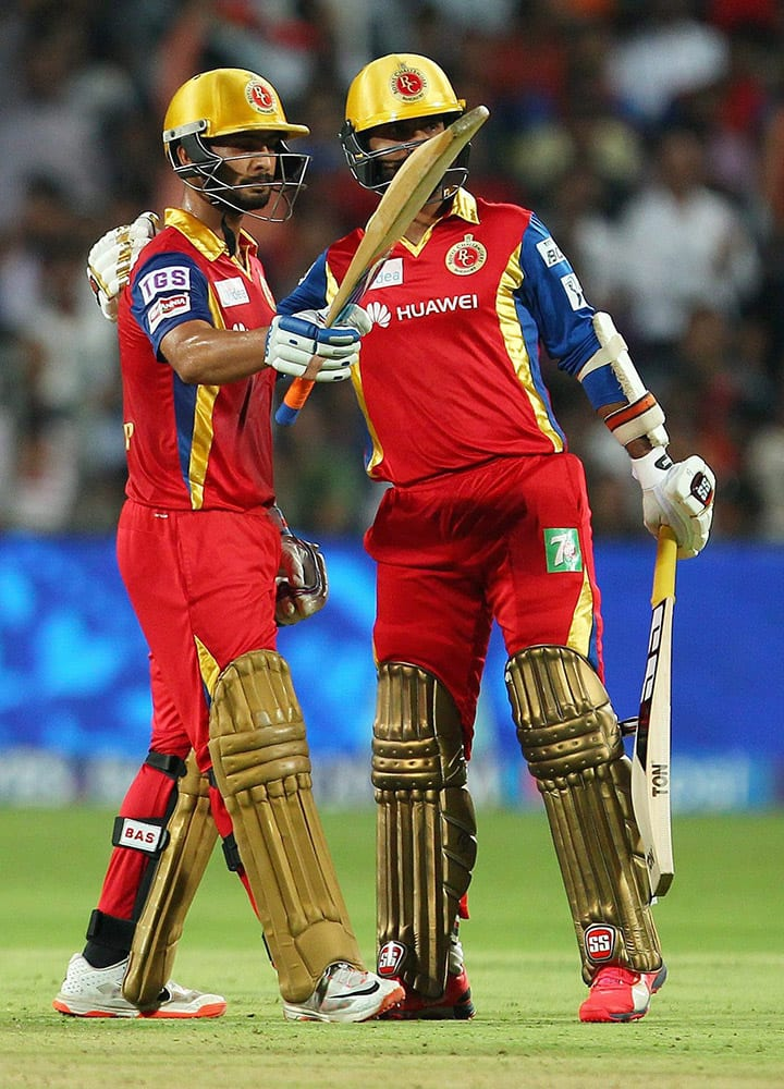 Mandeep Singh of the Royal Challengers Bangalore celebrates his fifty during the eliminator match of the IPL 2015 against Rajasthan Royals at the MCA International Stadium in Pune.