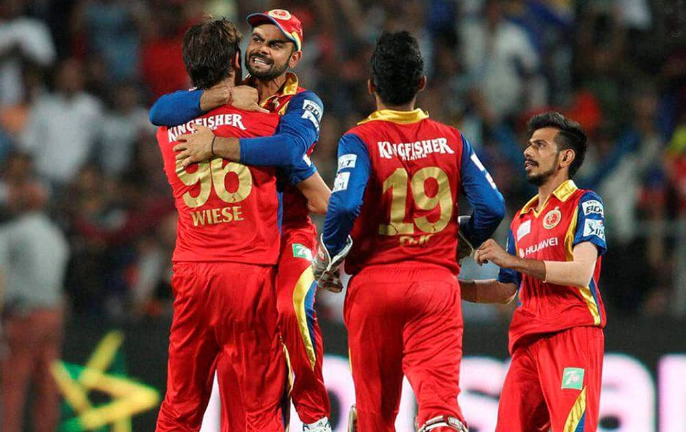 Royal Challengers Bangalore captain Virat Kohli congratulates David Wiese of the Royal Challengers Bangalore for getting Rajasthan Royals captain Steven Smith wicket during the eliminator match of the IPL 2015 at the MCA International Stadium in Pune.