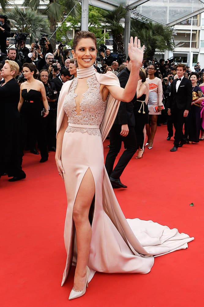 Singer Cheryl Ann Fernandez-Versini waves to members of the public upon arrival for the screening of the film Irrational Man at the 68th international film festival, Cannes, southern France.