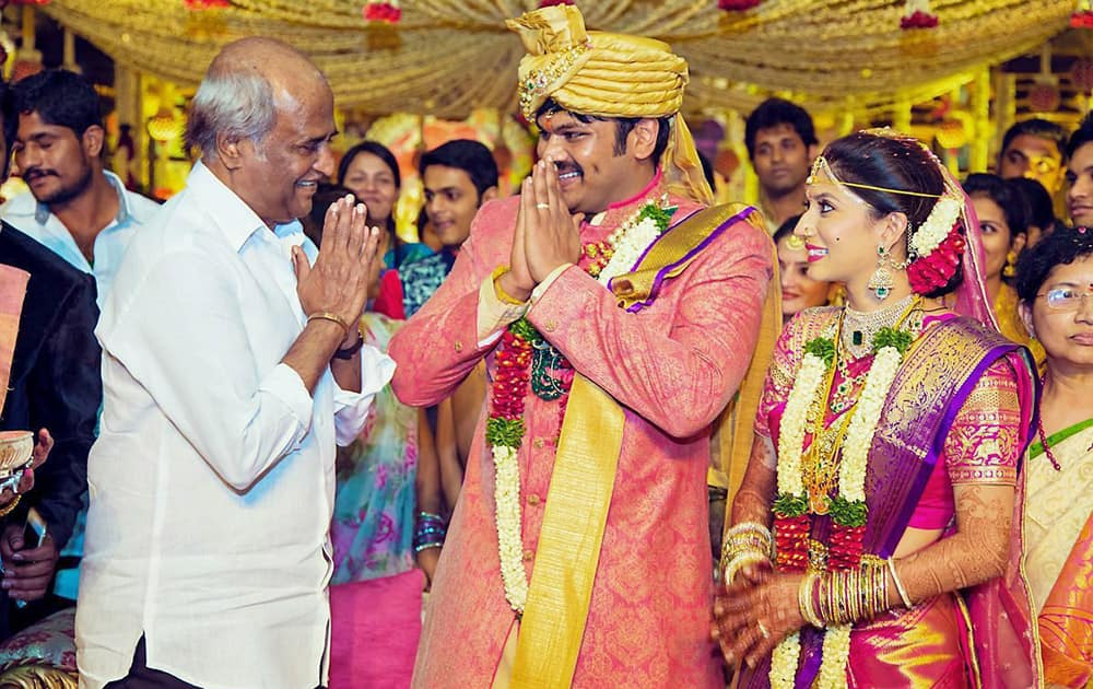 Rajinikanth greets actor Mohan Babus son Manchu Manoj during his wedding ceremony in Hyderabad.