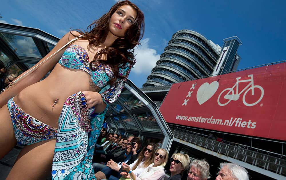 A model sports beachwear designed by Gottex during the Canal Catwalk fashion show with clothing dedicated to Kate, Duchess of Cambridge, during the first edition of the World Fashion Fair in Amsterdam, Netherlands.