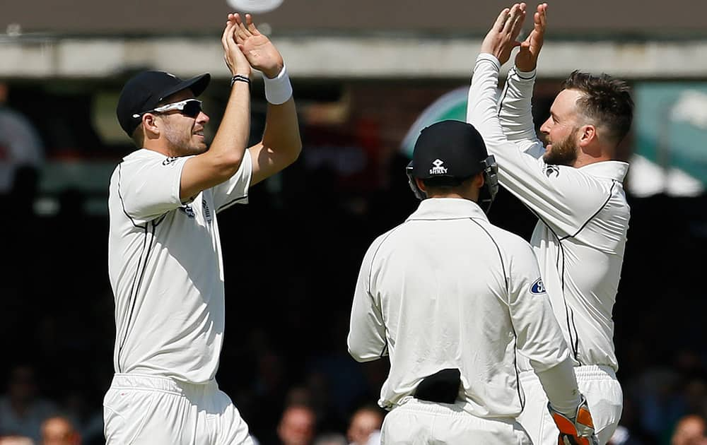 New Zealand's Mark Craig celebrates the wicket of England's Ben Stokes, bowled for 92, during the first day of the first Test match at Lord's cricket ground in London.