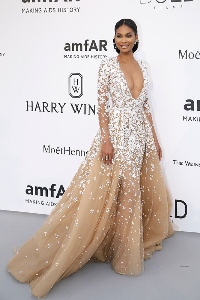 Model Chanel Iman poses for photographers upon arrival for the amfAR Cinema Against AIDS benefit at the Hotel du Cap-Eden-Roc, during the 68th Cannes international film festival, Cap d'Antibes, southern France.