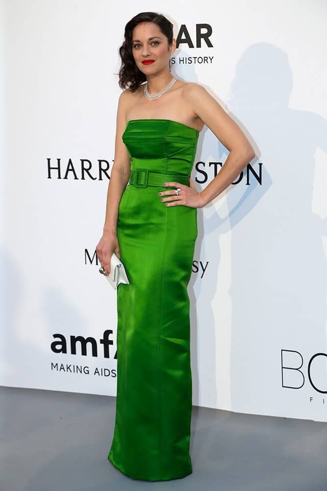 Actress Marion Cotillard poses for photographers upon arrival for the amfAR Cinema Against AIDS benefit at the Hotel du Cap-Eden-Roc, during the 68th Cannes international film festival, Cap d'Antibes, southern France.