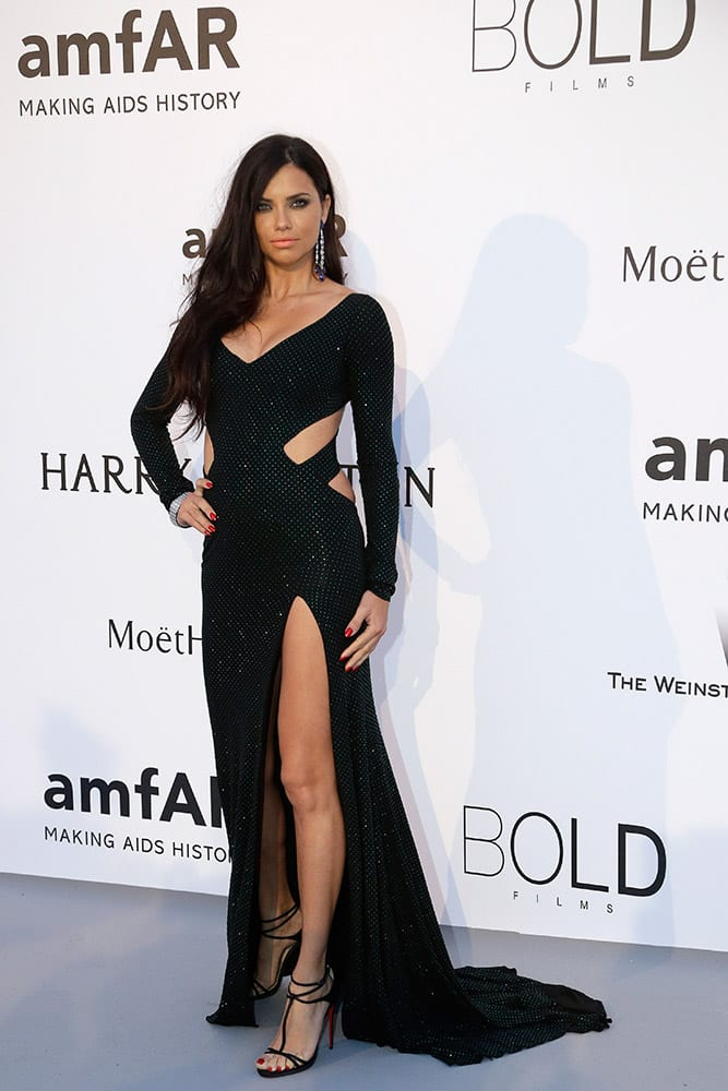 Model Adriana Lima poses for photographers upon arrival for the amfAR Cinema Against AIDS benefit at the Hotel du Cap-Eden-Roc, during the 68th Cannes international film festival, Cap d'Antibes, southern France