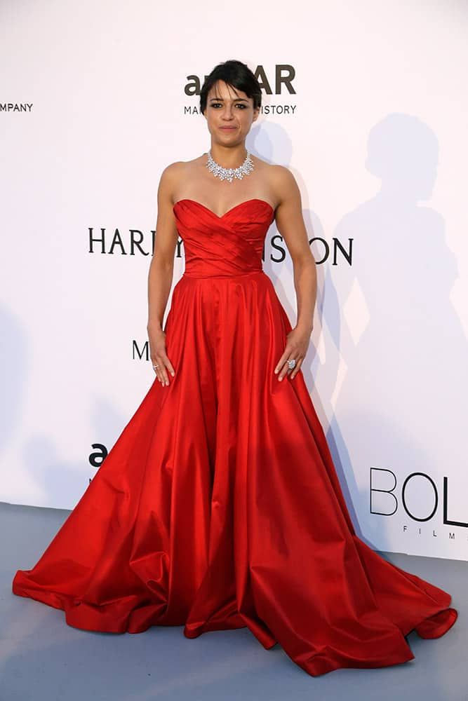 Actress Michelle Rodriguez poses for photographers upon arrival for the amfAR Cinema Against AIDS benefit at the Hotel du Cap-Eden-Roc, during the 68th Cannes international film festival, Cap d'Antibes, southern France.