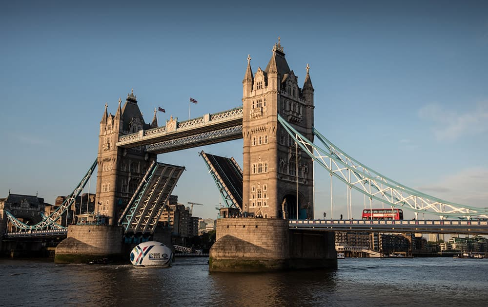 Land Rover floats a giant 8.2 metre high rugby ball along the Thames under Tower Bridge to reveal the bespoke Rugby World Cup 2015 Land Rover Defender which features a tailor-made display cabinet to showcase the Webb Ellis Cup, in London, England.