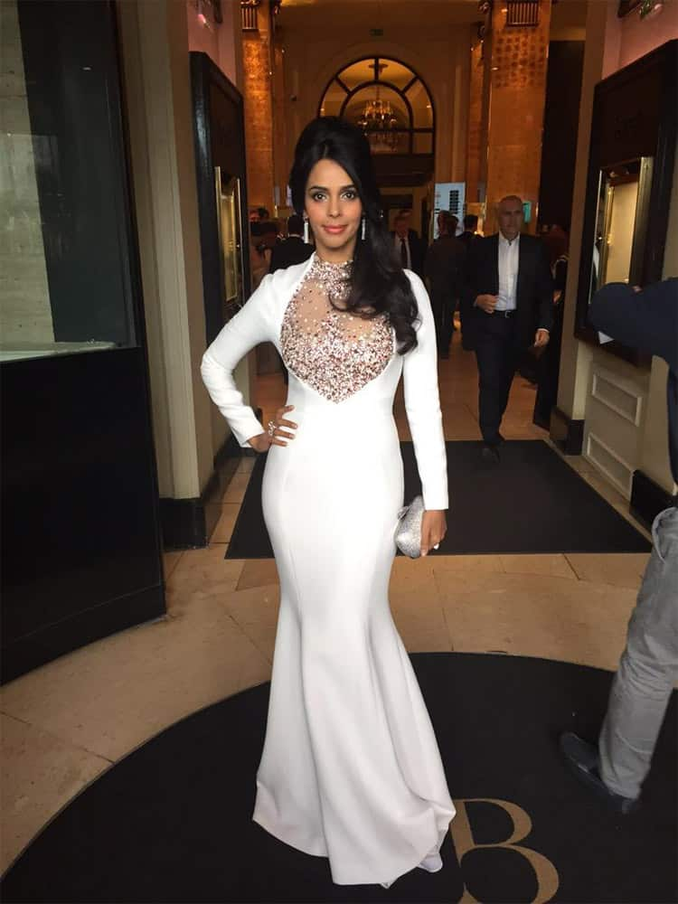 On my way to #amfARCannes , loving the @GeorgesHobeika gown  @swarovski clutch, diamonds by @Boucheron makeup. Twitter@mallikasherawat