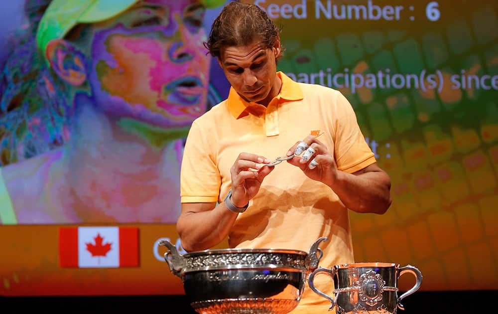 Defending champion Spain's Rafael Nadal picks a token during the draw for the French Tennis Open at the Roland Garros stadium in Paris.