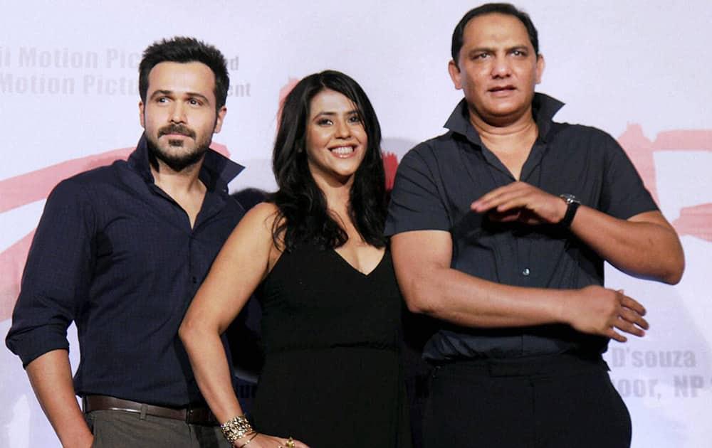 Mohammad Azharuddin with Ekta Kapoor and Emraan Hashmi pose at the preview of film Azhar, in Mumbai.