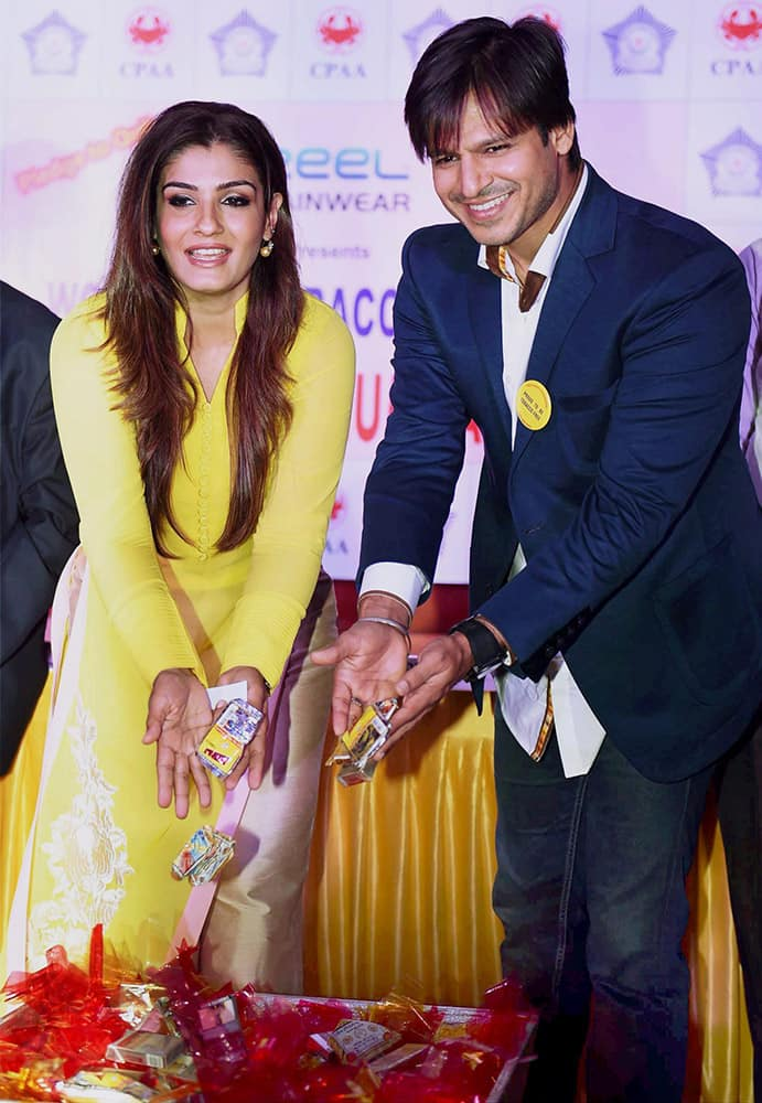 Raveena Tandon and Vivek Oberoi at the launch of Tobacco free Mumbai Police Station initiative in Mumbai.