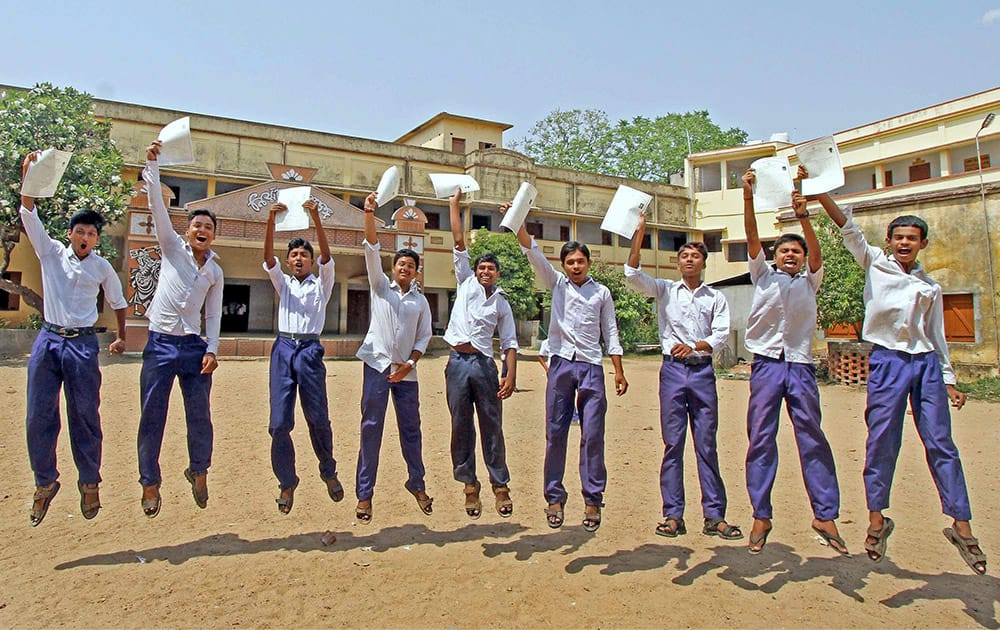 Students celebrate their success in the West Bengal Board Class 10th Examination after their results were declared at Bolpur in Birbhum district of West Bengal.