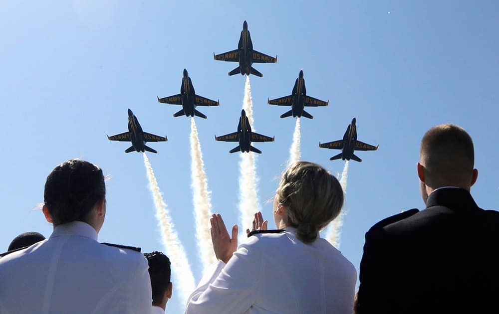 The Blue Angels flight demonstration team flies over graduating members of the U.S. Naval Academy during a graduation and commissioning ceremony in Annapolis, Md.
