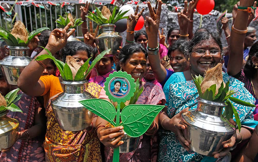 Supporters of AIADMK leader Jayaram Jayalalitha celebrate in front of her residence as news emerged that she could be sworn-in as the state chief minister on Saturday, in Chennai.