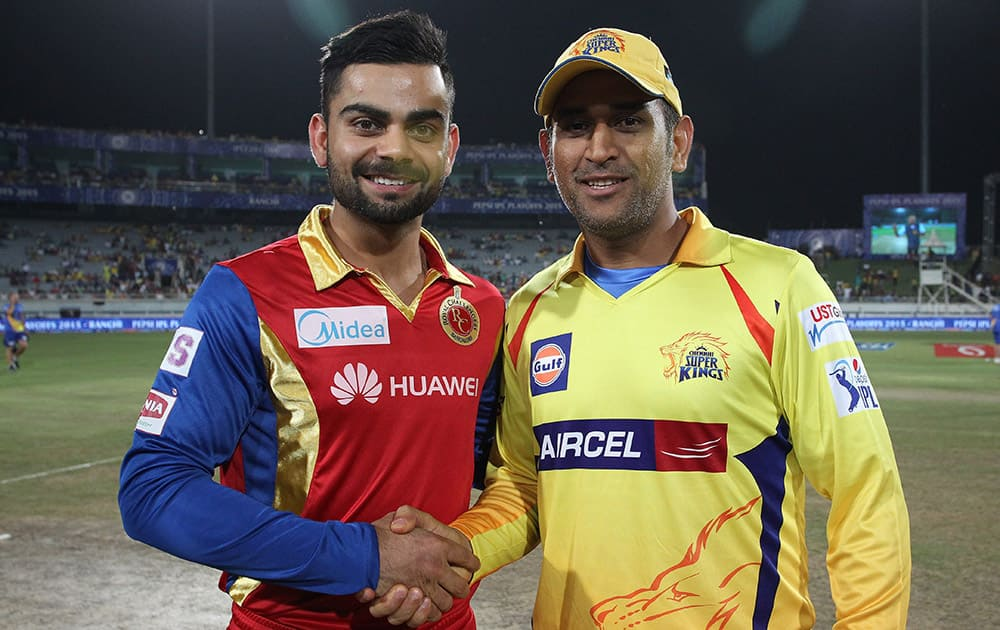 Royal Challengers Bangalore captain Virat Kohli and Chennai Super Kings Captain MS Dhoni shake hands after the toss of the 2nd qualifier match of the IPL 8 in Ranchi.