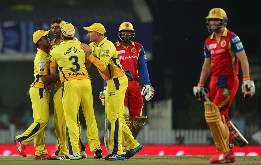 Chennai Super Kings players celebrate a wicket Royal Challngers Bangalores batsman during the 2nd qualifier match of IPL 8 at Ranchi.
