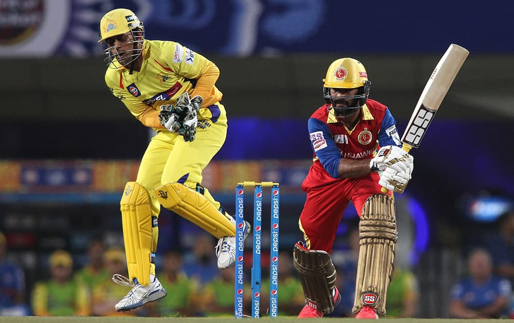 Dinesh Karthik of Royal Challengers Bangalore plays a shot against Channai Super Kings during 2nd qualifier match of IPL 8 at Ranchi.