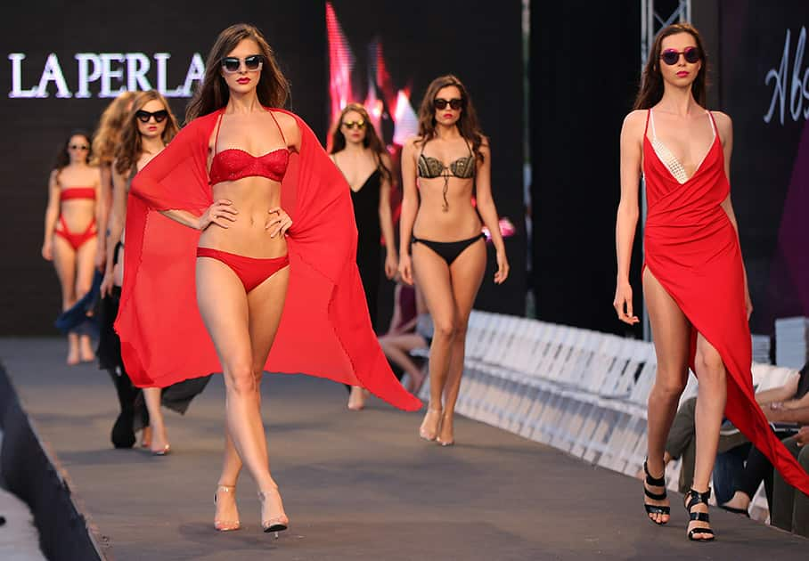 Models display creations part of the Italian fashion label La Perla's Spring-Summer 2015 beachwear collection, during the summer fashion week at Saint George Yacht Club, in Beirut, Lebanon.