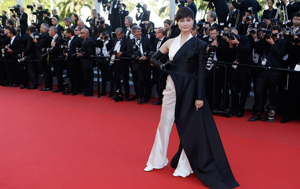 Singer Li Yuchun poses for photographers upon arrival for the screening of the film The Little Prince at the 68th international film festival, Cannes.
