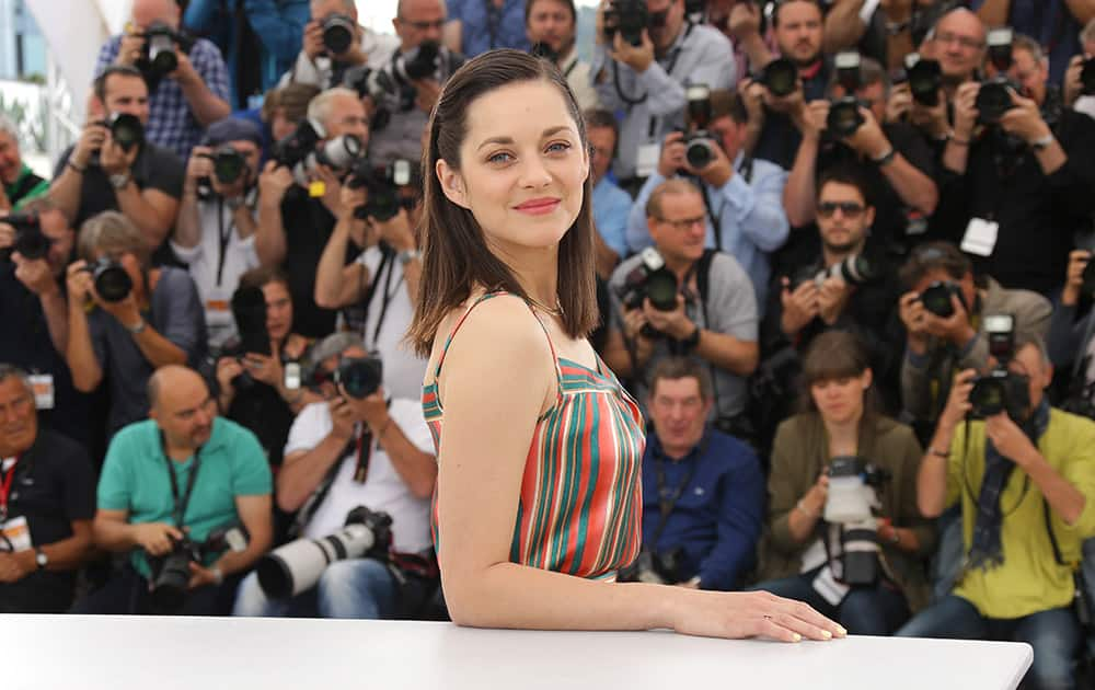 Marion Cotillard poses for photographers during a photo call for the film Macbeth, at the 68th international film festival, Cannes, southern France.