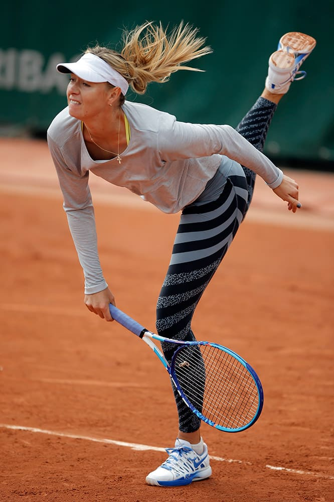 Defending champion Russia's Maria Sharapova practices during a training session for the French Tennis Open at the Roland Garros stadium, in Paris.