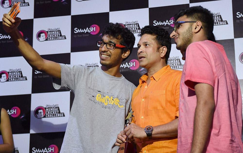 Fans take a selfie with Master Blaster Sachin Tendulkar during Smaaash Mumbai Cricket Challenge felicitation ceremony in Mumbai.