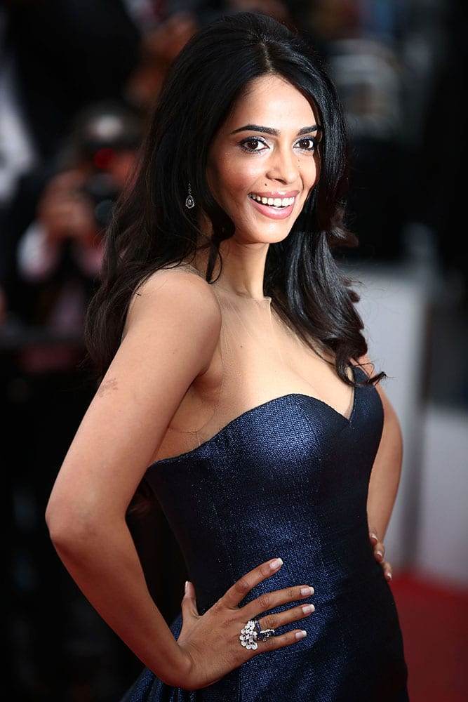 Actress Mallika Sherawat pose for photographers upon arrival for the screening of the film Macbeth at the 68th international film festival, Cannes.