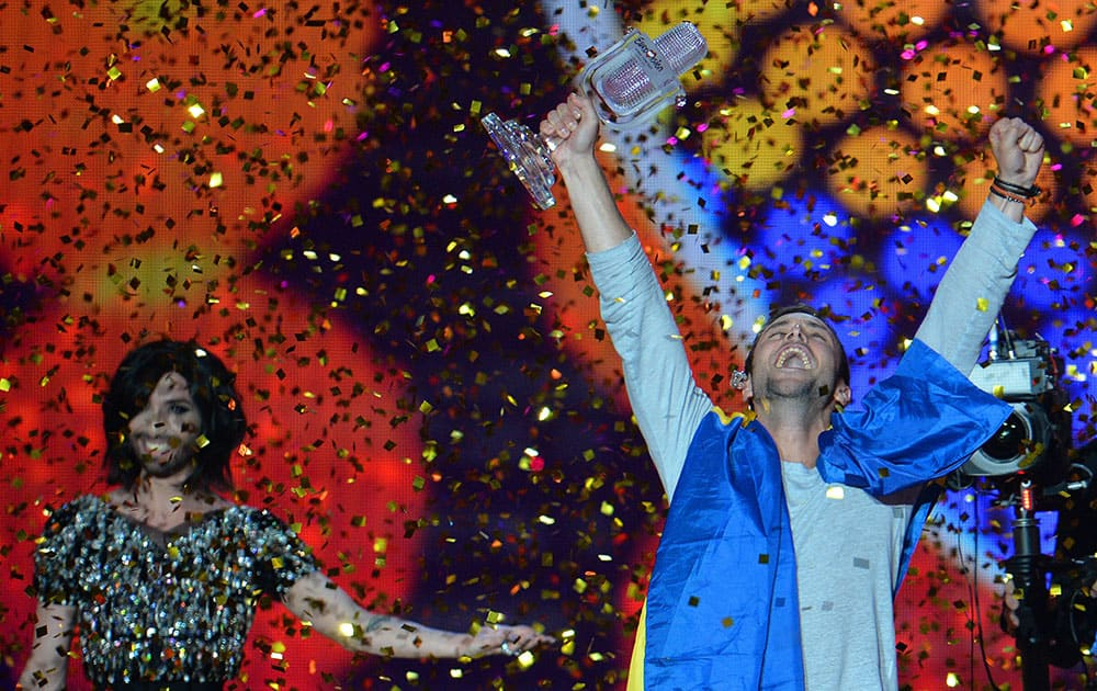 Mans Zelmerlow representing Sweden celebrates with the trophy after winning the final of the Eurovision Song Contest in Austria's capital Vienna.