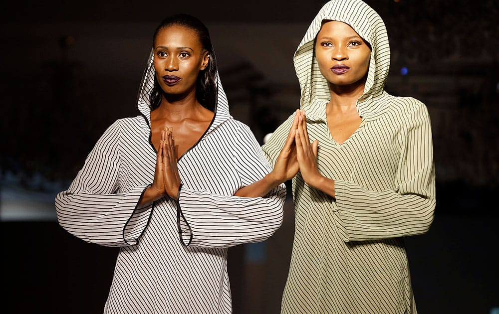 Models strike a pose on the runway during the launching of a new fashion clothing line DENNIZ fashion Limited in Lagos, Nigeria.